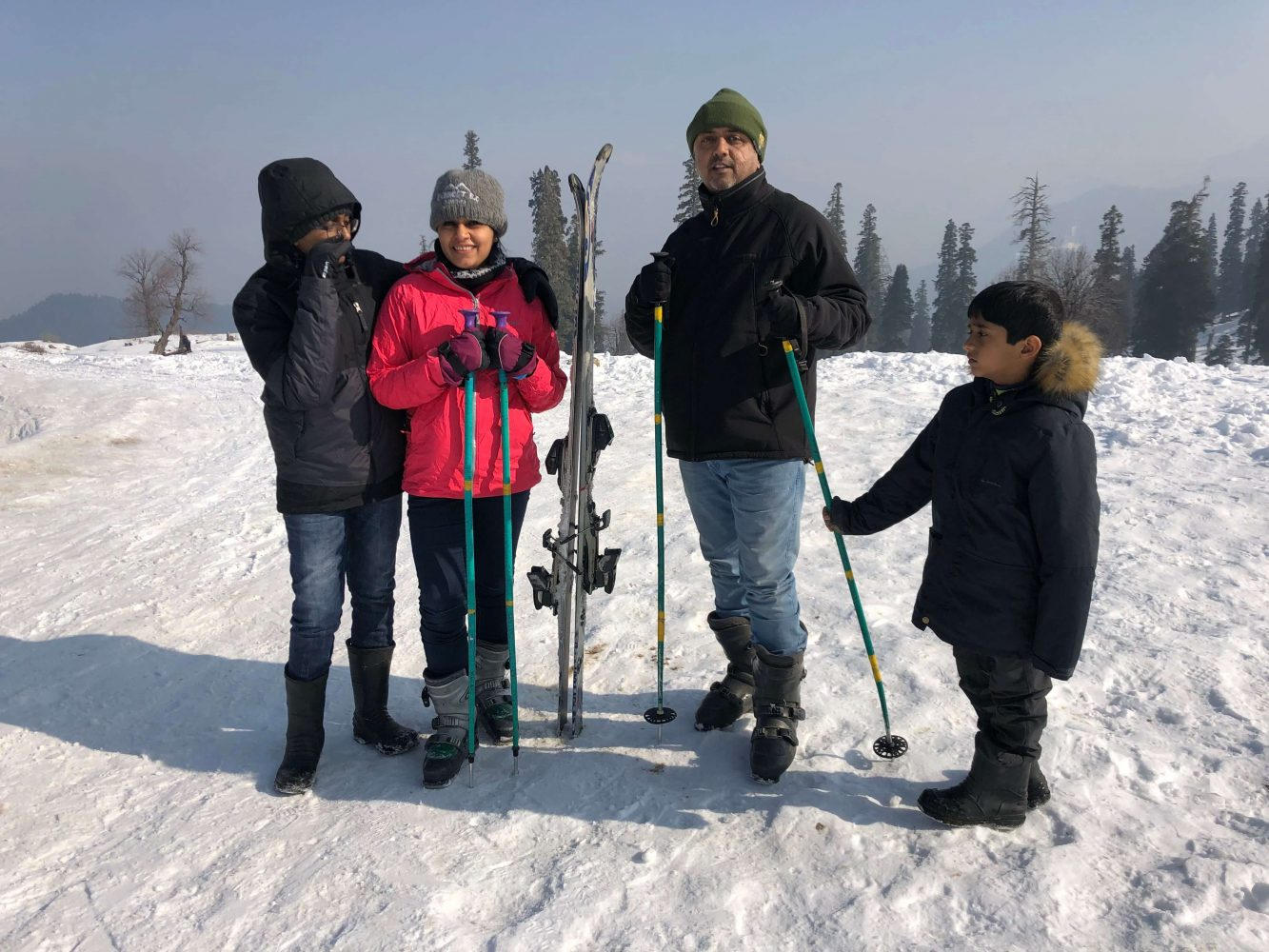 Family sharing skiing experiences together on a vacation