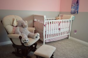 Crib in the baby room walls painted with antibacterial paint