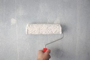 Wall being painted with antibacterial paint
